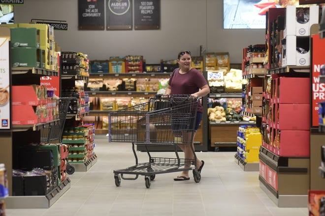 One of the first shoppers takes a look at the new Aldi store in Bucyrus after the grand opening Thursday morning.