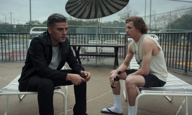 "Oscar Isaac and Tye Sheridan in ""The Card Counter."""