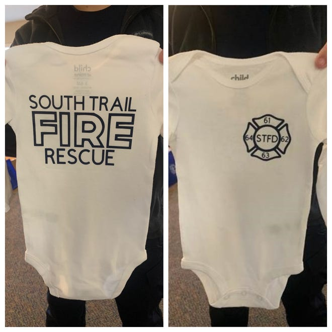 After firefighters at South Trail Fire Rescue helped a mother who delivered her son in a car outside Station 62 Tuesday the department dropped off a baby gift that included diapers, a fire truck and and this specially made onesie uniform.