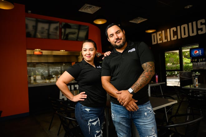 Luis and Lydia Stark pose for a portrait at the Woodruff Road location of their restaurant, Holy Molli, Wednesday, Sept. 9, 2021. The Starks will be opening up their third location in downtown Greenville by the end of the year.