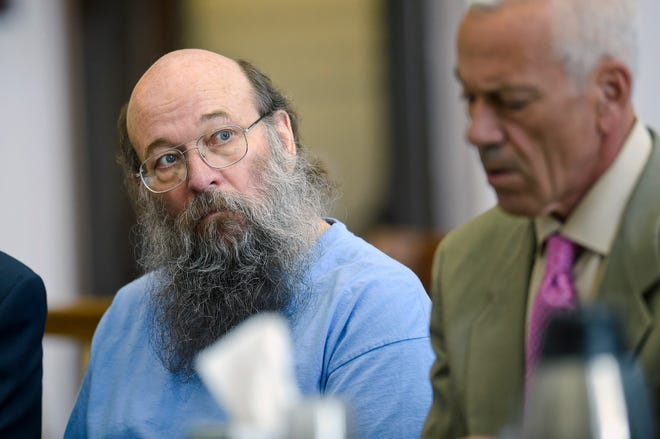 This June 7, 2018, file photo shows Lloyd Barrus, left, appearing before District Court Judge Kathy Seeley in Helena, Mont., for a status hearing regarding charges stemming from the killing of Broadwater County Sheriff's Deputy Mason Moore in May 2017.