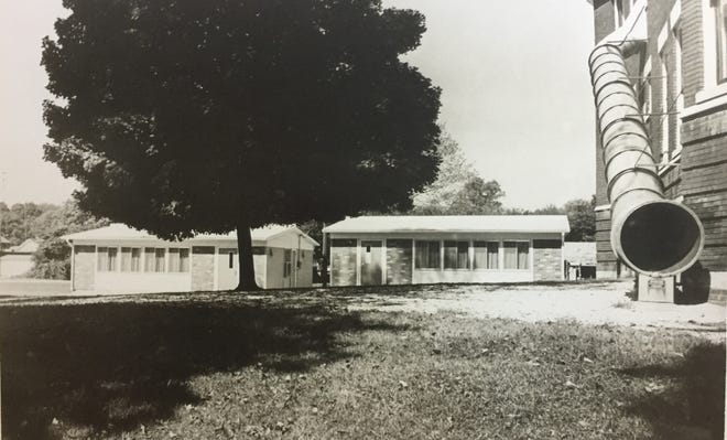 Two temporary classrooms for the fourth grades were set up at Seventh Street Elementary School in 1971 to deal with the school's rapidly expanding enrollment, according to an article and photos that appeared in The Gleaner Sept. 15, 1971. At right is the old school's fire escape.  Students were thankful to have air conditioned classrooms, which had not been available at the school before then. (Gleaner file photo by Keith Williams)