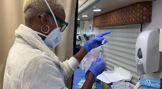 Nikki Love, a nurse at the Marion County Public Health Department, prepares a vaccine at a mobile vaccination clinic on on Sept. 3, 2021. The health department is hosting weekly vaccination clinics at the Julia M. Carson Transit Center through the month of September.