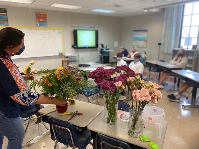 Carrie Leonard, licensed florist and owner of Posh Bouquet, talks with seventh-graders in Lauren Daly's math class at Ascension Episcopal School about how she uses certain math concepts in her everyday life.