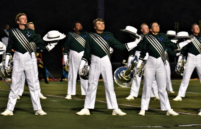 Joe Zishka, center, a Lancaster High School senior, pictured with the Madison Scouts during one of their summer performances.