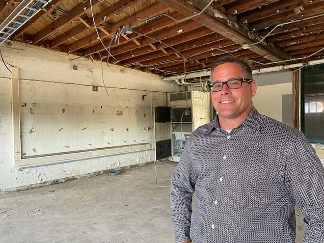 Howell developer Chris Bonk poses in a room that will become The Means Project's retail center on Sept. 7, 2021 at 935 W. Main St. in Pinckney
