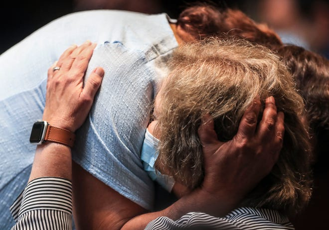 Kentucky state Senator Dr. Karen Berg hugs fellow Sen. Alice Forgy Kerr after Kerr's speech about wearing a mask and the loss of a 15-year-old to the virus on the third day of the special session. Sept. 9, 2021.