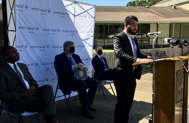 Saifodeen Andesh speaks during a news conference about Afghan resettlement at the World Relief headquarters in East Memphis on Thursday, September 9, 2021. Now 30, he said he arrived in Memphis as a refugee from Afghanistan in 2014 and is currently volunteering to help World Relief in its refugee resettlement efforts. Behind him are (from left) Shelby County Mayor Lee Harris, Memphis Mayor Jim Strickland and PJ Moore, director of World Relief Memphis.