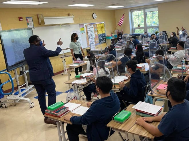 Superintendent Keith Posley talks with students on the first day of school at Rogers Street Academy.