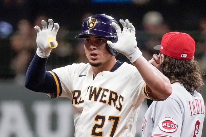 Milwaukee Brewers' Willy Adames reacts to his double during the first inning of a baseball game against the Cincinnati Reds Tuesday, Aug. 24, 2021, in Milwaukee, Wisconsin.