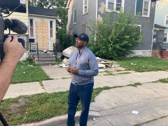 Ald. Ashanti Hamilton speaks to media regarding the garbage piling up outside homes in the Garden Homes neighborhood in his district Thursday.