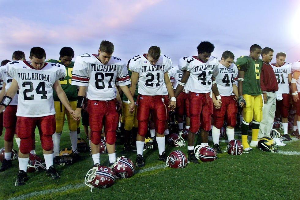 Tullahoma High and Hillsboro High players take a moment prior to their game Sept. 14, 2001 at Hillsboro to honor those victims in the tragic incident that happened in New York Sept. 11.