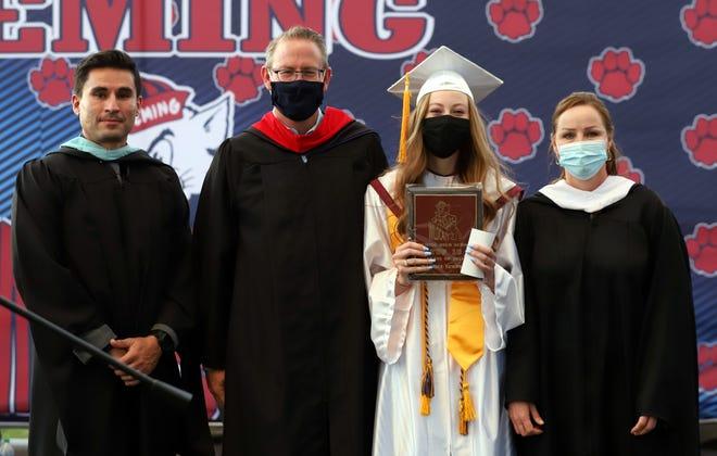 From left are asst. principal Gaspar Lozano, Principal Bryan Simpson, Rachel Simpson and counselor Joli Zumwalt.