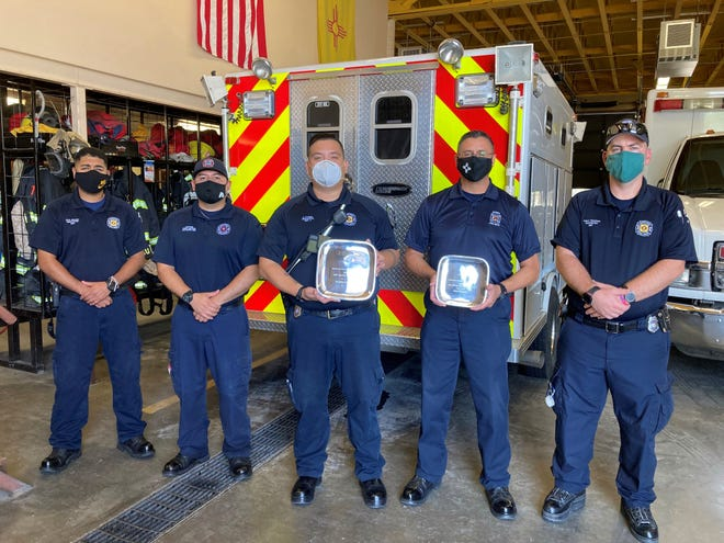 From left are Deming Fire Department personnel Erick Jimenez, Captain Chris Holguin, Lt. Emmanuel Flores, assistant chief Raul Mercado and Robert Sweetser. Firefighters.EMTs are holding the New Mexico EMS Department of the Year award and the Joe Tibbetts Leadership award.