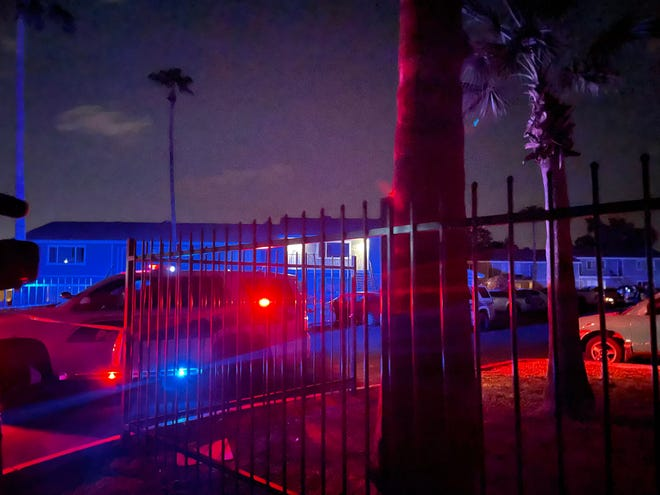 Phoenix police respond to a scene where two children were killed and a woman was critically injured near 13th Street and Mountain View Road on Sept. 8, 2021.