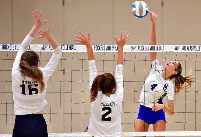 From right, Spring Grove's Hailey Wolfe hits the ball down while Dallastown's Olivia Oppedisano and Marissa Greathouse defend during girls' volleyball action at Spring Grove Area High School in Jackson Township, Wednesday, Sept. 8, 2021. Dawn J. Sagert photo