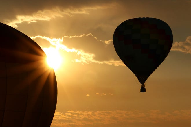 Balloons take flight during a mass ascension on media day for the 2021 Great Reno Balloon Race on Thursday morning, Sept. 9, 2021.