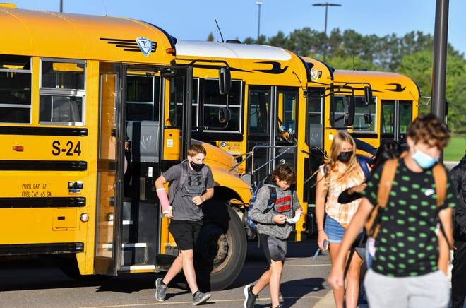 Students leave buses during the first full day of school Thursday, Sept. 9, 2021, at Tech High School in St. Cloud.