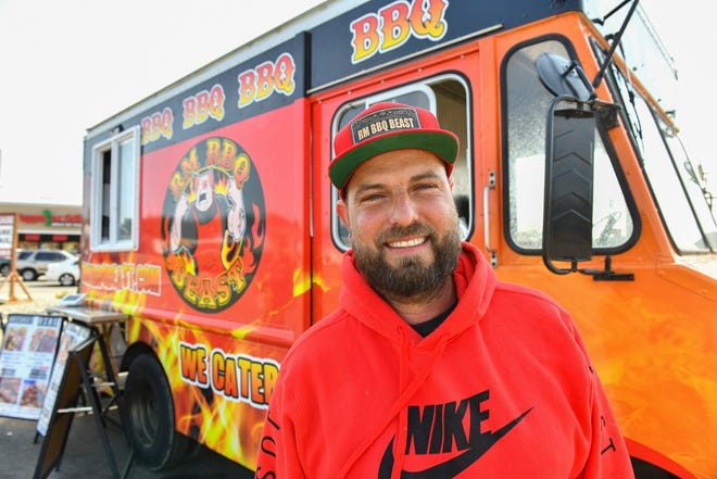 Russ Moss stands outside his food truck, RM BBQ BEAST, Thursday, Sept. 9, 2021, in St. Cloud.