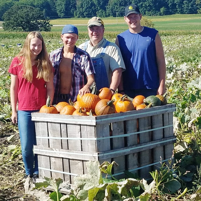 Randy Tietz and his sons Jacob and Christian and daughter Angela are busy picking pumpkins on their Lebanon farm for the busy fall season.  They spent Labor Day, as they always do, laboring in the field.  They are the sixth and seventh generations to operate this farm.