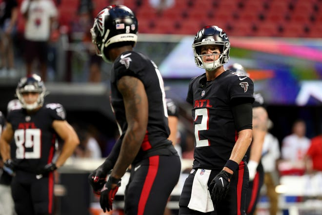 The chemistry between veteran quarterback Matt Ryan, right, and rookie tight end Kyle Pitts will have a major impact on the success of the Falcons offense in 2021.