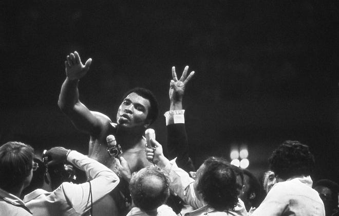 Muhammad Ali talks with the press after winning back the Heavyweight Championship for an unprecedented third time by beating Leon Spinks at the Super Dome in New Orleans, LA. September 15, 1978 in an image from PBS's documentary about the boxer.