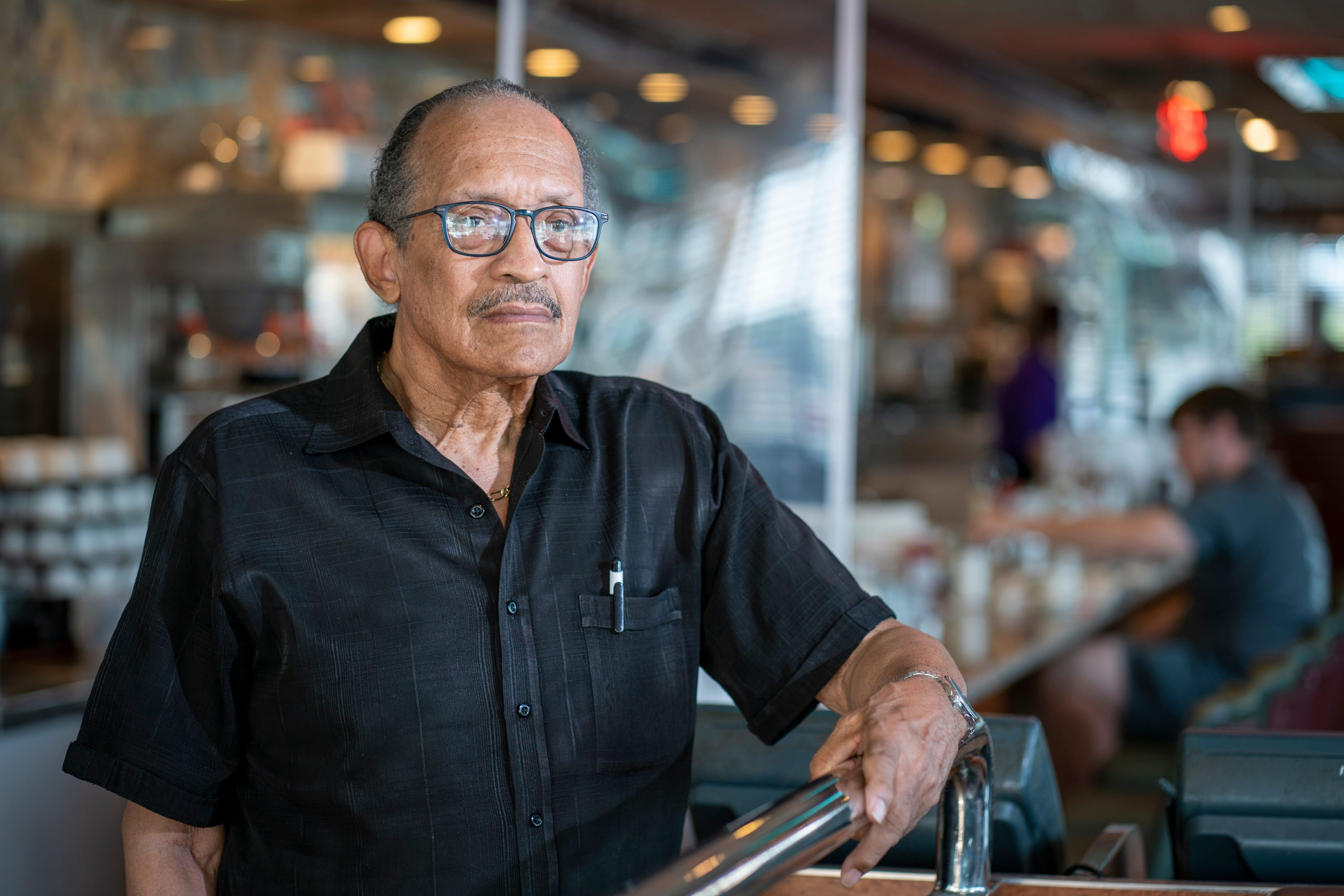 Charles Mason stands for a portrait in the Double T Diner, where he was arrested in a 1961 effort to desegregate the restaurant.