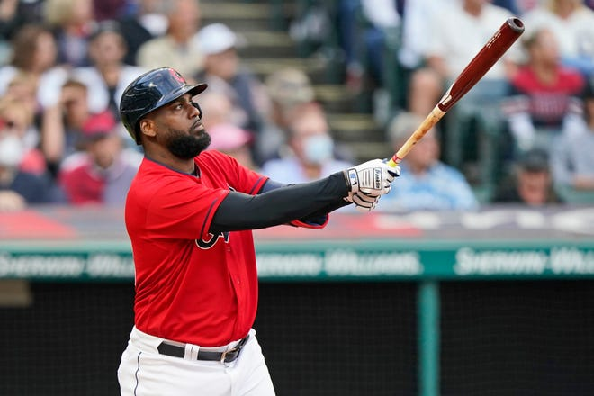 Cleveland's Franmil Reyes watches his two-run home run during the third inning of the team's baseball game against the Minnesota Twins, Thursday, Sept. 9, 2021, in Cleveland. (AP Photo/Tony Dejak)