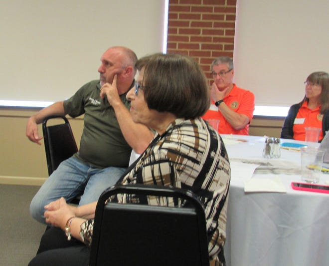 From left, Mayor Jesse Nehez , Northfield Center Township administrator Helen Humphrys, Jeff Campbell and Lynn Campbell of Mosquito Hunters in Bedford listen to a presentation during Thursday's State of the Communities.