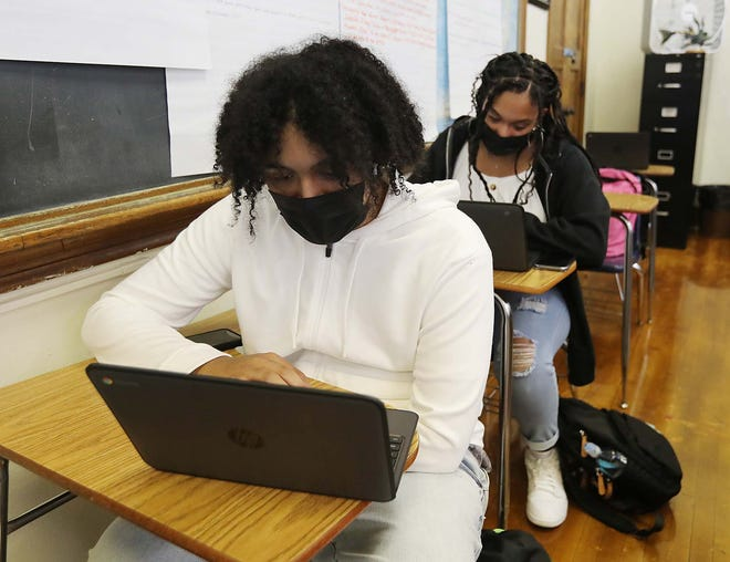 Nicholas Reese, 18, front, and Amaree Clark, 17, in their language arts class Friday at North High School.