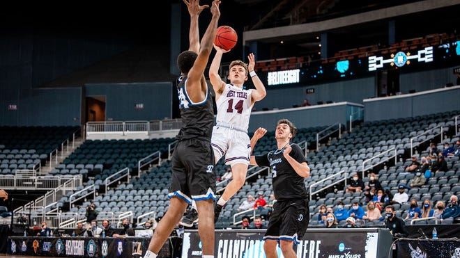 WT's Zach Toussaint (14) shoots a floater against Daemen in the NCAA DII Elite Eight game on March. 24, 2021 at Ford Center in Evansville, Indiana.
