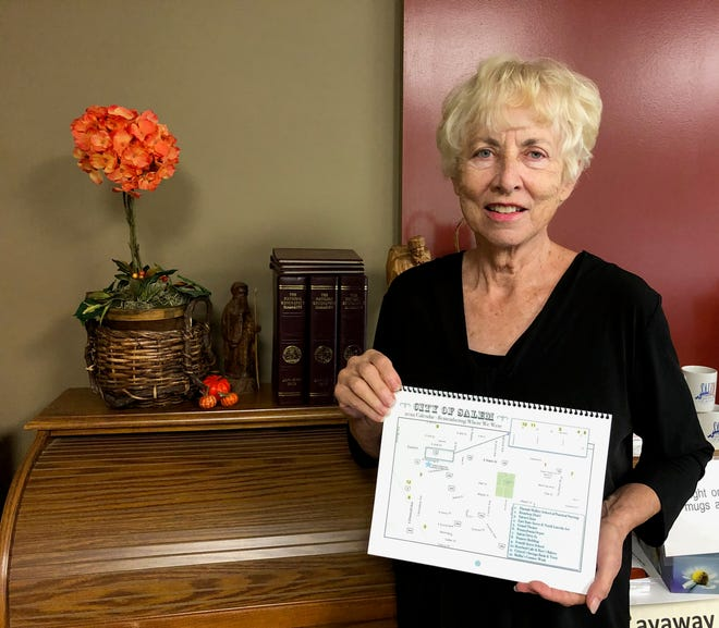 Mary Lou Adams shows off the map that is on the front cover of a calendar that Salem Historical Society will be selling. The map shows off the sites that are featured each month in the calendar.