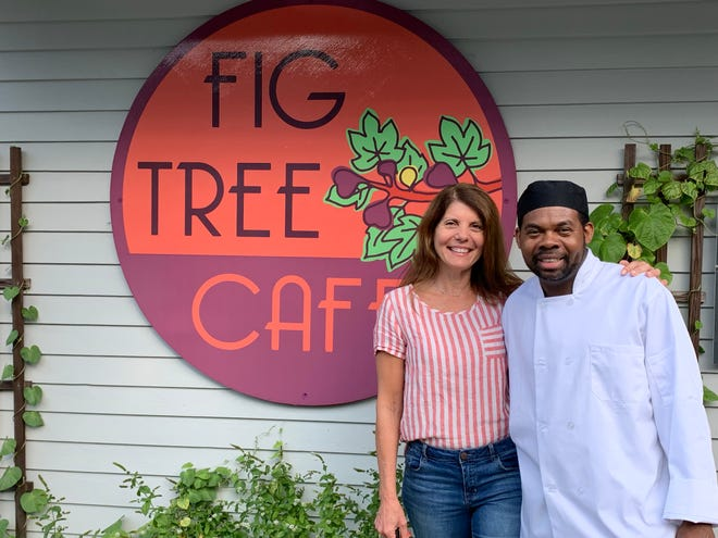 Maria Ferguson, owner of The Fig Tree in Marstons Mills, and chef Oneil Reed, celebrate their cafe's one-year anniversary on Sept. 16.