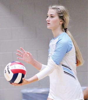 Kara Stotts prepares to serve the ball Thursday for Bartlesville High School during a sweep of visiting Enid High.