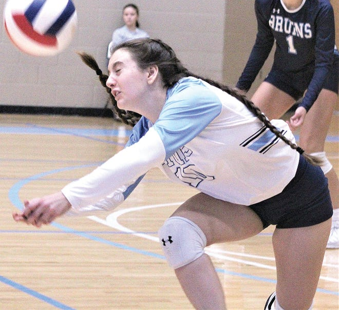 Bartlesville High's Reid Foust goes all out to make a tough pass during Thursday's home volleyball victory against Enid High.