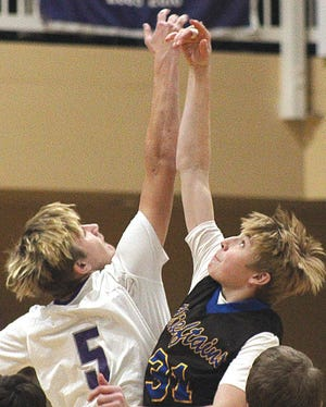 Wesleyan Christian School's Landon Norris, left, jumps center last basketball season.