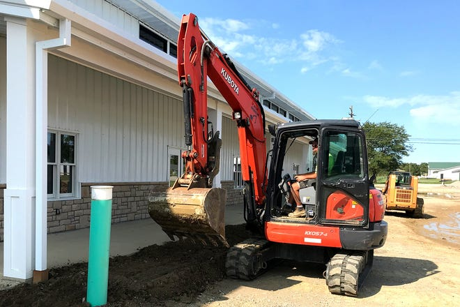 Brian Miley of Delaware-based Bruce A. Miley Excavating puts some finishing touches to the landscaping at the Delaware County Fairgrounds' newly completed Agricultural Center. The building will house both the fairgrounds office and Junior Fair still exhibits during the 2021 Delaware County Fair, which is scheduled to be open to the public Sept. 18-25.