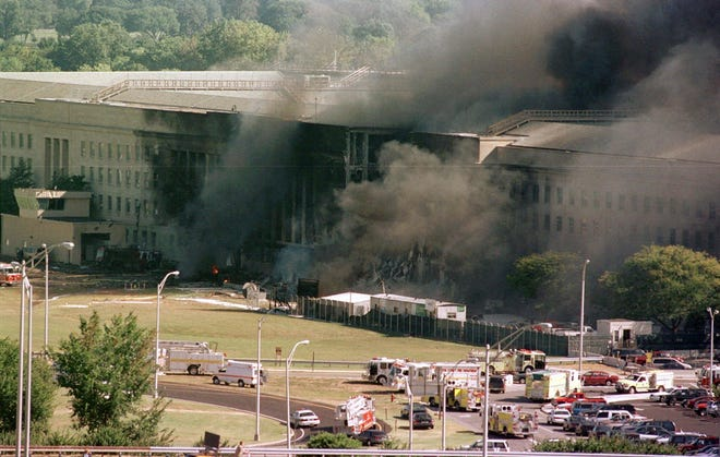 FILE - In this Sept. 11, 2001 file photo, the south side of the Pentagon burns after a plane crash in Washington. Newly released Pentagon documents show that Air Force officers debated briefly about burial at sea before concluding that 1,321 unidentifiable fragments of remains from the 9/11 attack on the Pentagon should be treated as medical waste and incinerated. (AP Photo/Tom Horan, File)