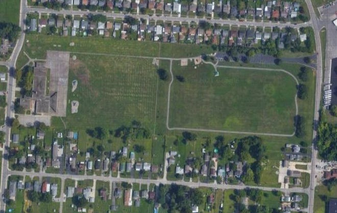 Columbus City Council in July 2020 approved spending more than $2 million to purchase the former Stockbridge Elementary School property, located at left center in this aerial photo along South Champion Avenue on the city's South Side, and plant thousands of trees there.  The property is adjacent to the city's Stockbridge Park, shown at right center in the photo with the forked asphalt drive access and parking lot off the 3000 block of Louckbourne Road. Bruckner Road is at the top of the photo and Rumsey Road is at the bottom. (Google photo, 2019)