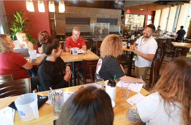 Chris Venci leads a wine and champagne tasting for employees at Moran's, a new bar opening soon at 415 N. Front St. in the Arena District.