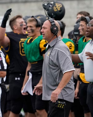 Adrian College football coach Jim Deere watches on from the sideline during the Bulldogs' Week 1 game at home against Heidleberg.