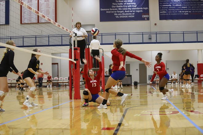 DCHS senior Camryn Lenz (13), setter for the Lady Demons, sets the ball for a spike by senior Mataya Clark (11) against the Hays Indians Sept. 9 during a quad match. The invitational included Lakin, Sublette, and Hays. The Demons fell short against Hays and Lakin but won against Sublette 2-0. The next varsity match for the Lady Demons will be on Sept. 16 against Liberal at Liberal High School.