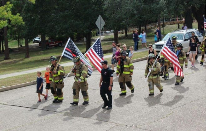 A mile-long walk on Circle Drive with first responders and attendees.
