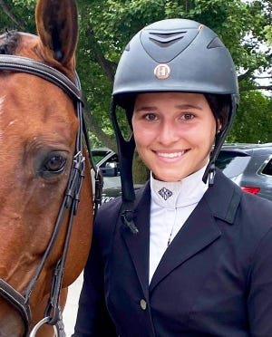 Wayne County's own Camden Bannan poses with her horse during local equestrian action.