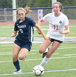 Central Valley Academy's Mira Bella Vitale (9) advances the ball with Madelynn Jones (11) defending for Vernon-Verona-Sherrill during the second half of Thursday's match.