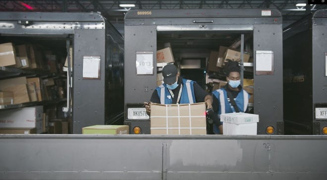 UPS workers sort packages for ground transportation on its trucks at a facility. The company said it plans to hire 1,770 seasonal employees in the Jacksonville area.