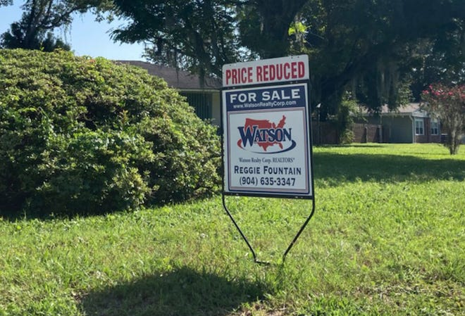 This sign at a house on Altama Road in Jacksonville's Southside amplifies the slight drop median sales prices for homes in August. That $300,000 median was unseen in Jacksonville until June but still dropped from the $305,000 the Northeast Florida Association of Realtors reported for July.