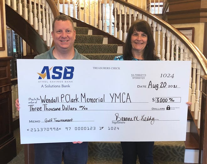 """Athol Savings Bank recently presented a $3,000 donation for the Charles E. Grout Golf Tournament """"Fore the Kids"""" at Templewood Golf Course in Templeton on Sept. 11. The event benefits youth programs at the Clark Memorial YMCA in Winchendon. Here, Michael Quinn, executive director of the Clark Memorial YMCA, left, accepts the donation from Deanne Keddy, community banking officer for Athol Savings Bank."""