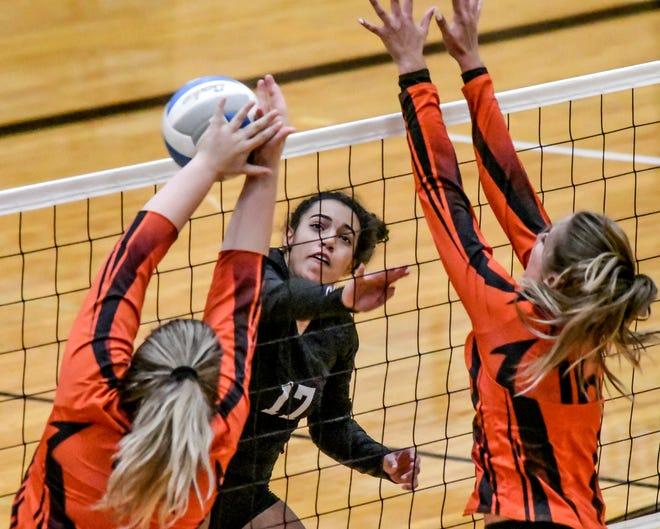 Garden City High School's Kamdyn Carr makes a kill against Lamar, Colo., Thursday during a volleyball dual at GCHS.
