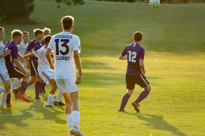 The Hillsdale Academy team chases a ball into the Royal's side of the pitch. Pictured in the foreground is (13) Sophomore Grant Walton.